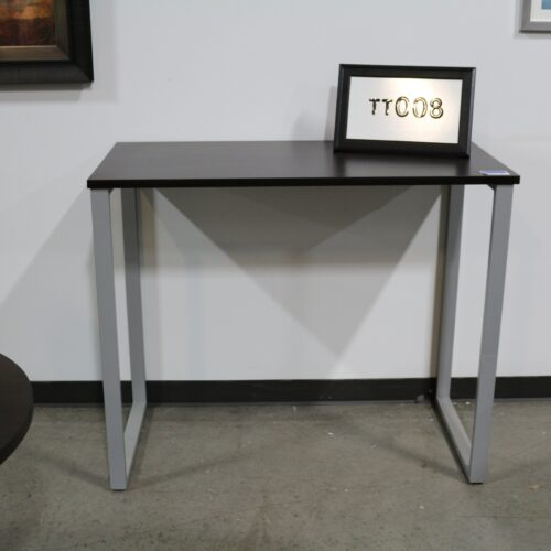 Picture of used espresso laminate training table with silver o legs for sale at Monarch Office Furniture